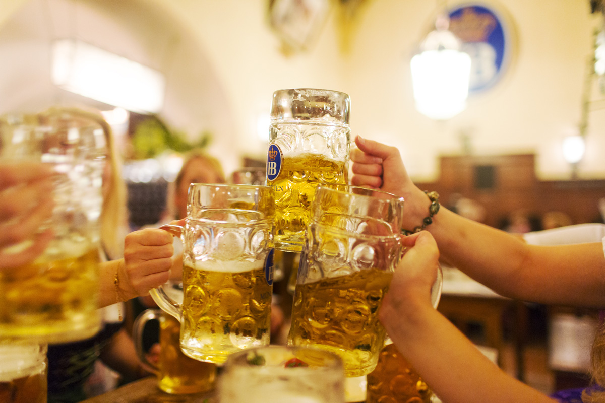 Friends on a pre-wedding 'Hen Party' make a toast with beers at the Hofbrauhaus, Munchen, Germany